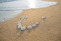 TUI logo written with stones in the sand